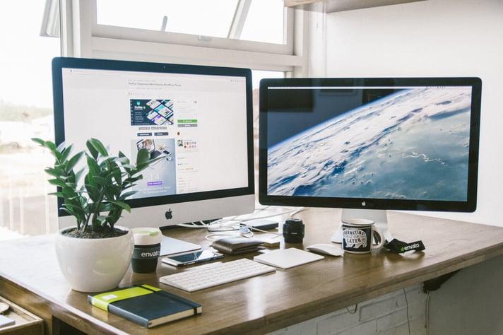 2 iMac on table